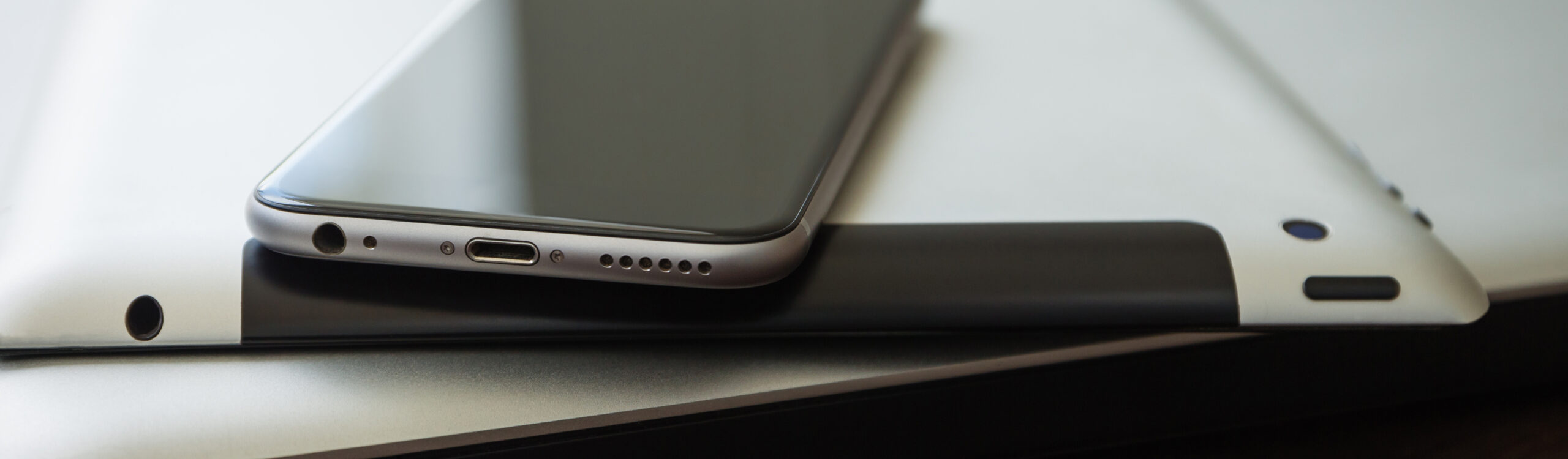 close up phone on tablet and laptop, new technology concept